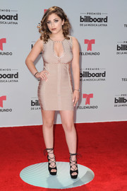 Baby Ariel sizzled in a beige bandage dress with a cleavage-baring neckline at the 2017 Billboard Latin Music Awards.