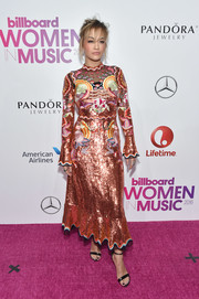 Rita Ora went for high-shine in an all-over sequined and embroidered dress by Temperley London at the Billboard Women in Music 2016.