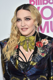 Madonna wore her long wavy hair swept to the side when she attended the Billboard Women in Music 2016.