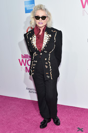 Debbie Harry chose a pair of black tassel loafers to complete her menswear-inspired look.