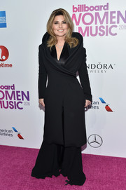 Shania Twain arrived for the Billboard Women in Music 2016 wearing a black wraparound coat with a sculptural neckline.