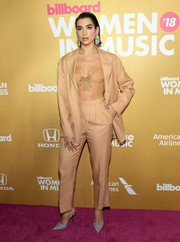 Dua Lipa added a touch of sparkle with a pair of silver slingbacks.
