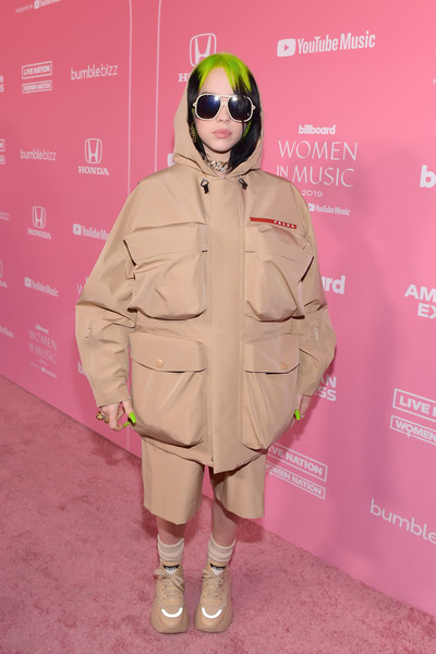 Billie Eilish completed her monochromatic attire with chunky nude leather sneakers, also by Prada.