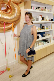 Vega Royo Villanova attended the Birchbox flagship store opening wearing a gray high-low maternity dress.