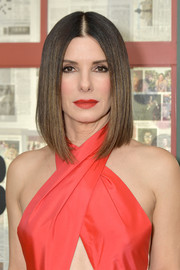 Sandra Bullock matched her lipstick to her red dress.