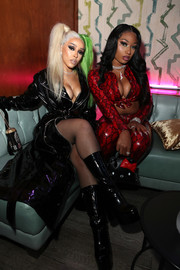 Doja Cat looked vampy with her black patent boots and coat combo at the 'Birds of Prey' event.