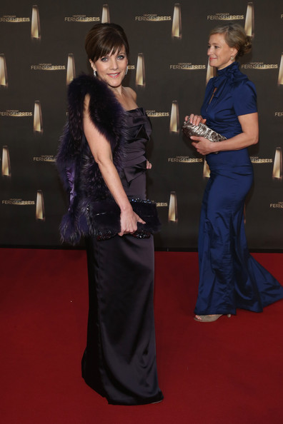 Birgit Schrowange Fur Scarf [carpet,red carpet,flooring,dress,hairstyle,fashion,premiere,event,award,little black dress,red carpet arrivals,deutscher fernsehpreis,tv award,german,cologne,coloneum,birgit schrowange]
