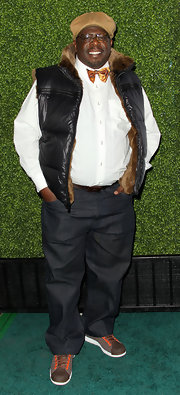 Cedric the Entertainer went for a fun and quirky look with a fur-lined down vest, a shimmery bow tie, and a newsboy cap.