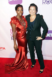 Estelle wore a decadent evening gown in an orange red hue for the 'Black Girls Rock!' event in NYC.