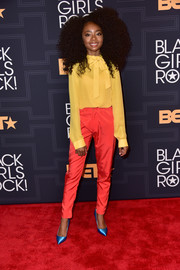 Skai Jackson went bold with colors, pairing her yellow blouse with orange silk pants, also by Christine Alcalay.