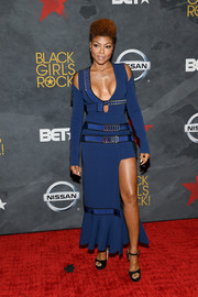 Taraji P. Henson flashed major cleavage in a plunging blue cutout dress by David Koma during Black Girls Rock! 2017.