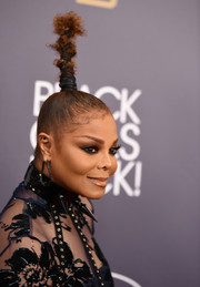 Janet Jackson attended the 2018 Black Girls Rock! event wearing a very tight, towering updo.