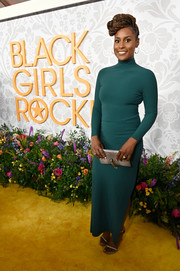 Issa Rae sheathed her figure in a body-con green maxi dress by Greta Constantine for Black Girls Rock 2019.