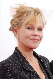 Melanie Griffith opted for a messy updo when she attended the 'Black Nativity' premiere.