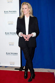 Kim Basinger kept her look tailored with these sleek black leather high heel ankle boots.