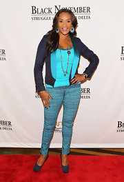 Vivica A. Fox wore a bright blue ensemble with this navy blazer that featured aqua lapels.