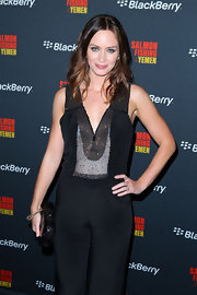 Emily Blunt accessorized her chic ensemble with a gold and diamond wave bracelet.