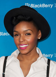 A fuchsia pink lip gave Janelle Monae's tomboyish red carpet look a little feminine fun.