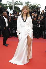 Petra Nemcova flashed her leg in a high-slit white wrap gown at the Cannes Film Festival screening of 'BlacKkKlansman.'