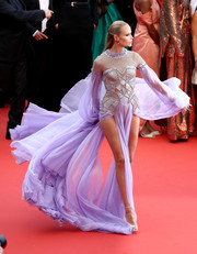 Natasha Poly looked fierce in an Atelier Versace gown with a silver cutout bodice and a lavender skirt and sleeves at the Cannes Film Festival screening of 'BlacKkKlansman.'