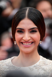 Sonam Kapoor opted for a center-parted braid when she attended the Cannes Film Festival screening of 'BlacKkKlansman.'