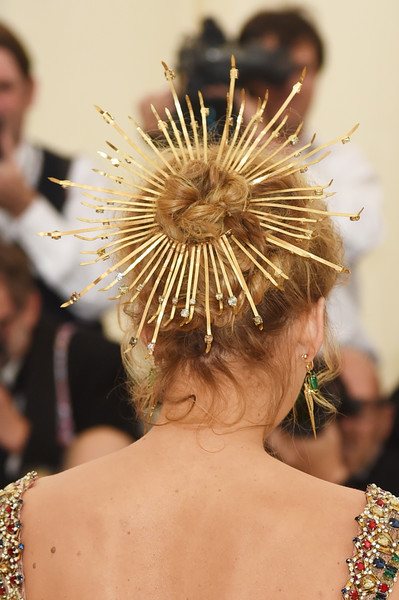 Blake Lively Twisted Bun [hair,hairstyle,fashion,headpiece,fashion accessory,headgear,hair accessory,chignon,haute couture,feather,blake lively,fashion detail,new york city,metropolitan museum of art,heavenly bodies: fashion the catholic imagination costume institute gala - arrivals]