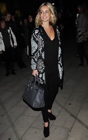 "Louise Redknapp showed up at the Blaze Press Night looking very sleek in her snakeskin cardigan and a classic ""Birkin"" bag."