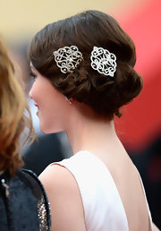 Katie Chang's matching hair barrettes have her pinned updo a lovely and romantic touch.