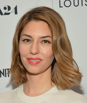 Sofia Coppola's honey blonde locks looked super sleek and shiny with this soft wave.