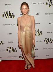 Sofia Sanchez Barrenechea chose a golden floor-length slip dress for her look at 'The Bling Ring' screening.