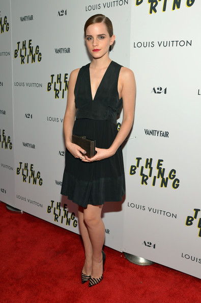 Emma Watson's clear striped stiletto pumps gave a modern retro feel to her look.