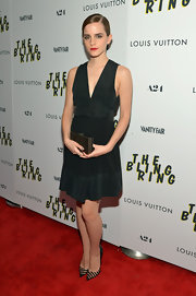 Emma Watson's deep V-neck LBD featured a silk bodice and hem gave the actress a simple and chic look.