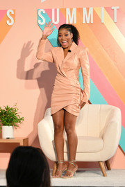 Keke Palmer styled her frock with silver ankle-wrap sandals.