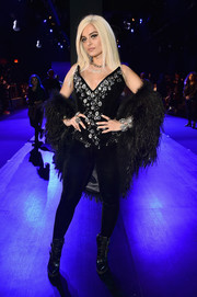 Bebe Rexha hit the Blonds fashion show wearing a strapless, crystal-embellished velvet catsuit from the label.