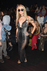 Paris Hilton oozed sex appeal wearing this sheer reptilian dress by The Blonds during the brand's fashion show.