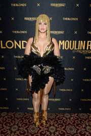 Dascha Polanco rocked a pair of gold Ruthie Davis ankle boots (that coordinated perfectly with her headpiece) at the Blonds x Moulin Rouge! The Musical show.