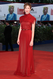 Alba Rohrwacher was pure elegance at the Venice Film Fest premiere of 'Blood of My Blood' in a high-neck red Valentino Couture gown with a pleated yoke overlay.