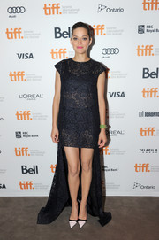 Marion Cotillard teamed vintage-looking black-and-white cap-toe pumps with a fishtail dress for the premiere of 'Blood Ties.'