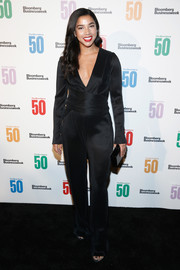 Hannah Bronfman was all about easy elegance in this deep-V black jumpsuit at the Bloomberg 50 celebration.