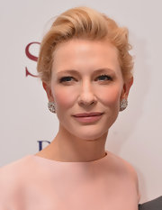 Cate's romantic look was topped off with a loose, brushed back French twist.
