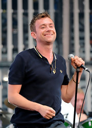 Damon Albarn rocked out in a Fred Perry polo shirt during a performance in Hyde Park.
