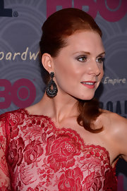 Christiane Seidel glammed it up with a pair of dangling gemstone earrings and a one-shoulder lace dress at the 'Boardwalk Empire' season four premiere.