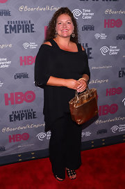 Aida Turturro added shine to her ensemble with a metallic gold tote when she attended the 'Boardwalk Empire' season four premiere.