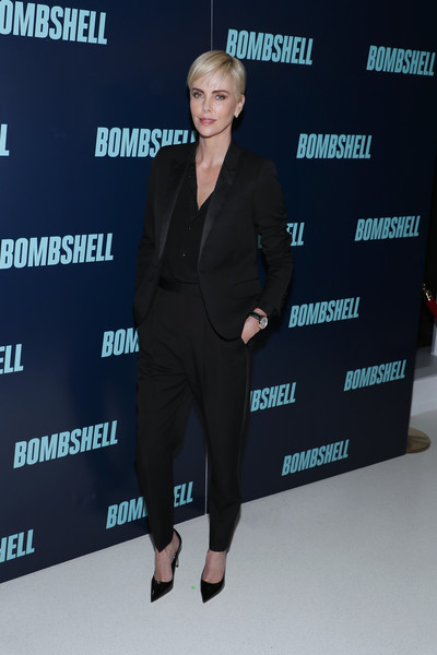 Charlize Theron went masculine-chic in a black Saint Laurent pantsuit at the special screening of 'Bombshell.'