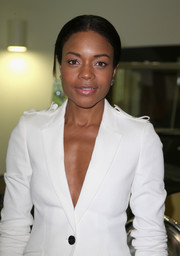 Naomie Harris kept it simple with this center-parted ponytail when she attended the Bond in Motion press preview.