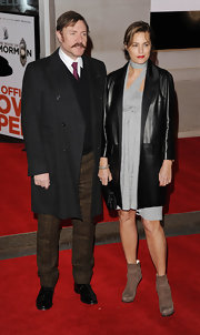 Yasmin Le Bon chose a sleek leather coat for her red carpet look at 'Book of Mormon.'