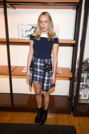 Chloe Sevigny teamed her top with a cute high-low plaid mini skirt.