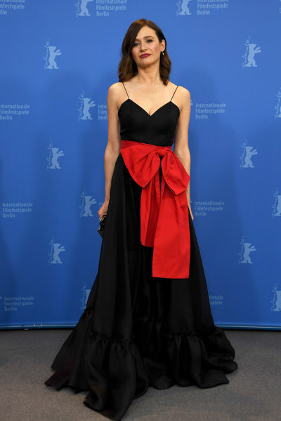 Emily Mortimer wowed in a princess-worthy black Novis gown with oversized red bow detailing at the Berlinale photocall for 'The Bookshop.'