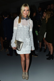 A gold clutch put some sparkle into Laura Whitmore's front row ensemble at Bora Aksu's fashion week show.