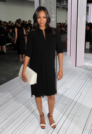 Zoe Saldana went for a subdued maternity look with this BOSS V-neck LBD during the label's fashion show.
